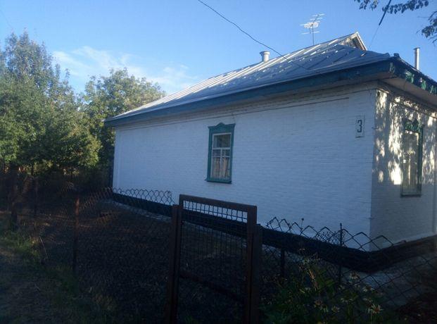 Продам дом в центре г. Кобеляки