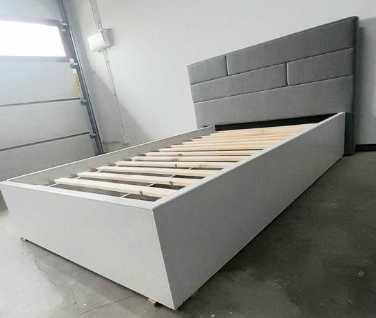 Łóżko drewniane z zagłówkiem tapicerowanym. 140x200
