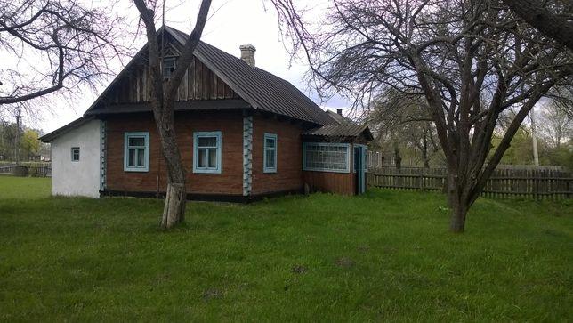 Продам дерев'яних будинок.