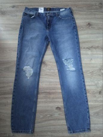 Nowe Spodnie Męskie Lee Rider Rurki Slim Jeansy W33 L32 L70144ZU
