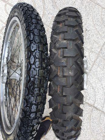 Vendo rodas de origem de dtr 125 com pneus novos...