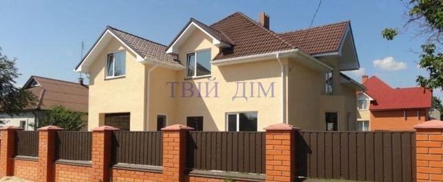 Продам дом 240 м.кв. с гаражом а 10 сотках