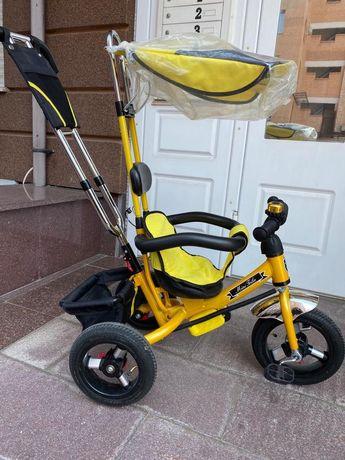 Детский трёхколёсный велосипед с ручкой