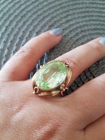 Złoty pierścionek z chryzolitem R21; 8.67 g / 5,67 g - wycena jubiler.