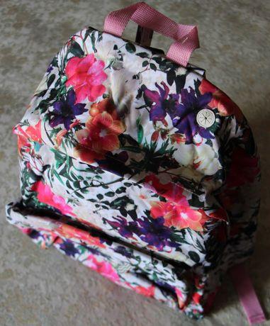 Mochila Note com flores coloridas
