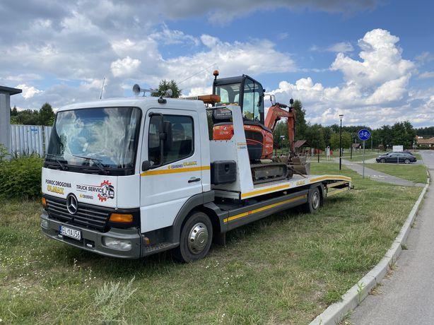 Pomoc drogowa transport maszyn budowlanych rolniczych usługi laweta