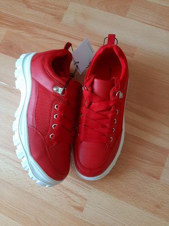 Кросівки червоні