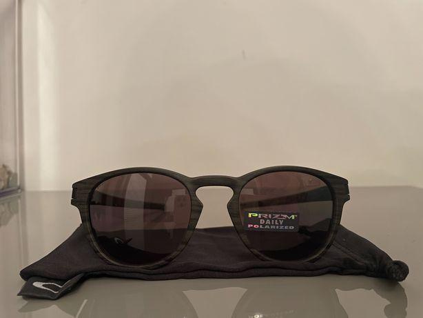 NOWE okulary przeciwsłoneczne OAKLEY OO9265-12 LATCH prizm polaryzacja
