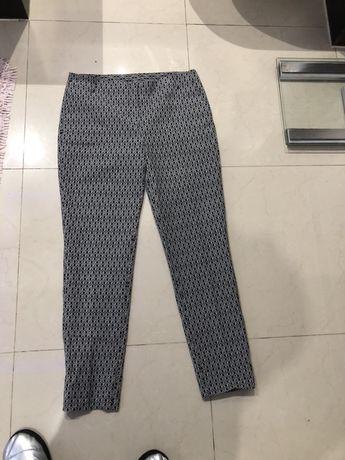 Spodnie bialo-czarne rozm.40
