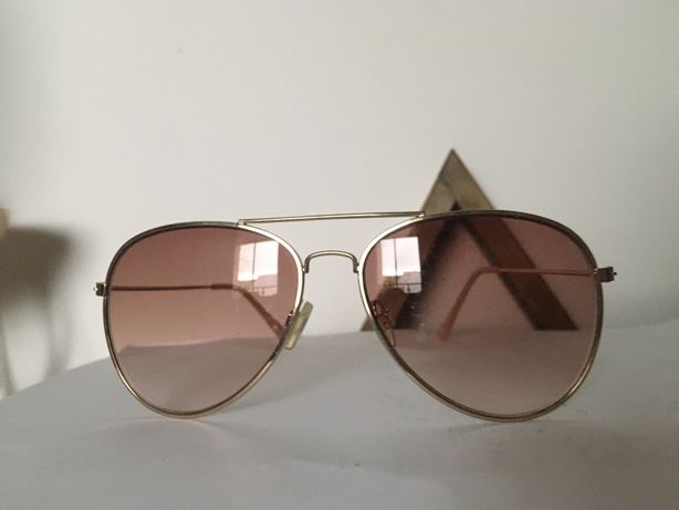 Rozowe okulary przeciwsloneczne z ramka w kolorze rozowe zloto kobiece
