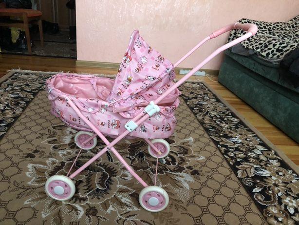 Дитяча коляска іграшкова. Детская коляска