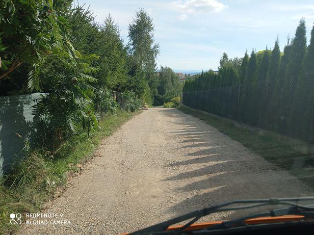 Utwardzenie drogi placu terenu budowa koparka kruszywo
