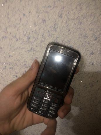 Єлитный кнопачносенсорный телефон Donod