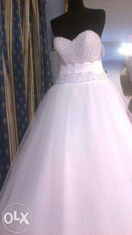 Sprzedam suknie ślubną z kryształami Swarovskiego i perełkami