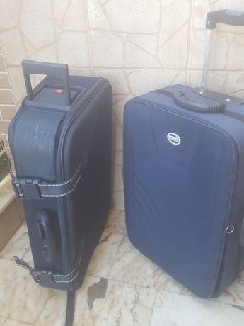 2 malas  de  viagem  dá  para  levar  a  mao  ou  como  trol