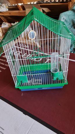 Клітки для хом'яка і попугая