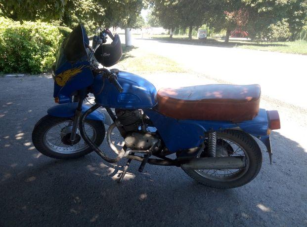 Ковровець торг у мотоцикла
