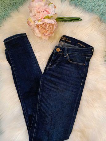 Spodnie jeansy Guess skiny rurki granatowe XS orginalne logowane