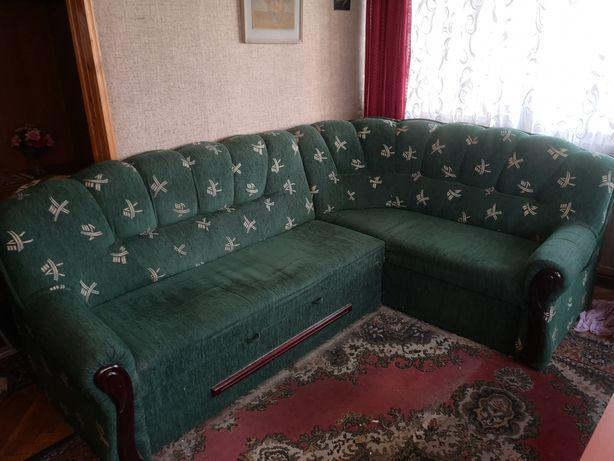 Śliczna zielona sofa narożna  rozkładana
