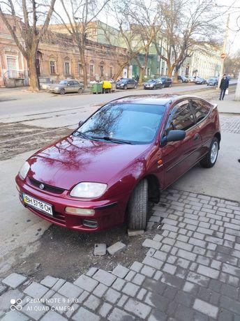 Машина Мазда 323