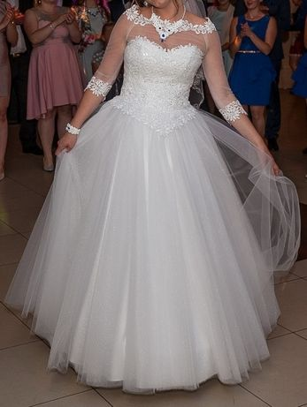 Mieniaca suknia slubna princessa rozkloszowana z dodatkami