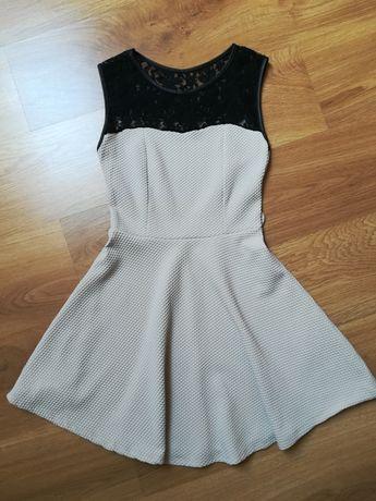 Sukienka damska - kloszowana. Rozm. XS - S
