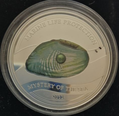 pięć dolarów -moneta z perłą