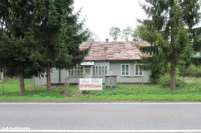Drewniany przy drodze wojewódzkiej + budynek gosp.