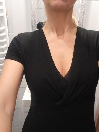 Czarna bluzka z krótkim rękawem z dekoltem, odcięta pod biustem