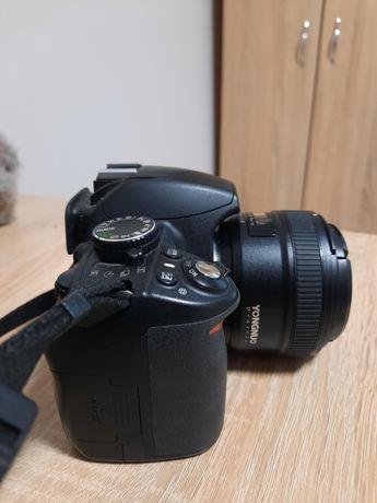 Продам фотоаппарат Nikon 3100 и обьектив yongnuo 50 mm 1/1,8 c сумкой