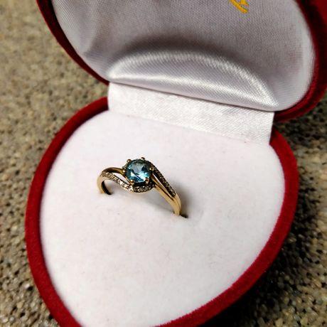 Złoty pierścionek z topazem oraz diamentami rozmiar 14