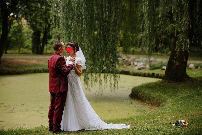 Koronkowa suknia ślubna rozmiar 36 z trenem