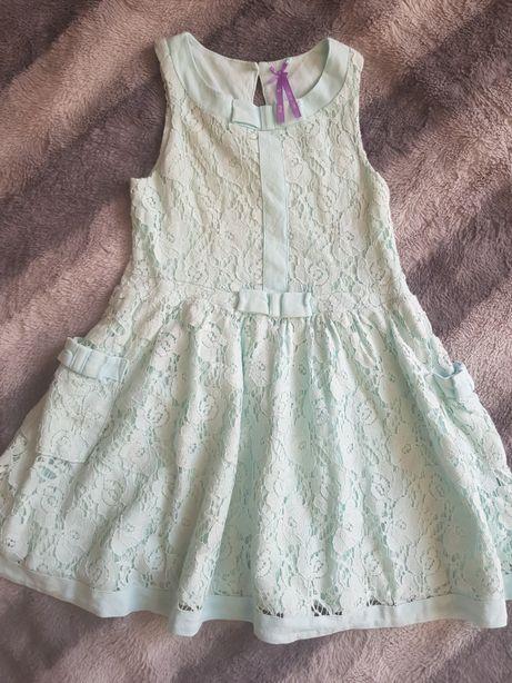 Śliczna miętowa sukienka Next rozmiar 116