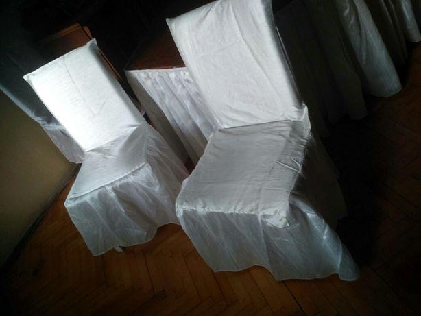 2 białe pokrowce na krzesła