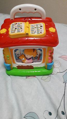 Розвивающая  музыкальная игрушка Говорящий домик