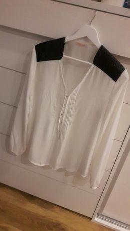 Elegancka biała koszula z długim rękawem i skórzanym wstawkami