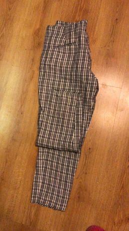 Spodnie garniturowe lniane damskie MANGO