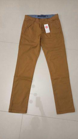 Spodnie chłopięce Cool Club by Smyk chinosy beżowe rozm. 152 nowe