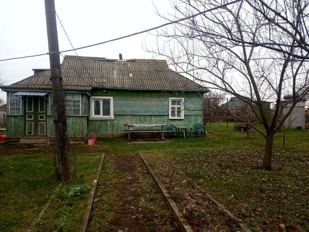 Земельна ділянка + будинок в смт. Баришівка