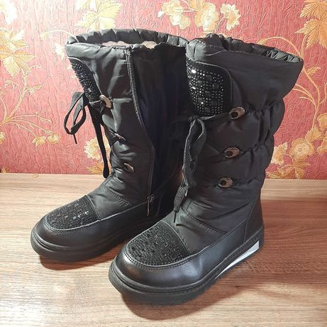 Високі зимові чобітки