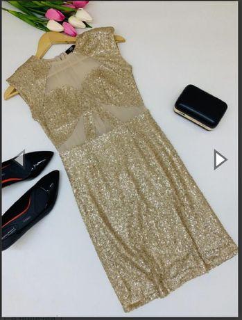 Роскошное платье в паетках золотистого цвета