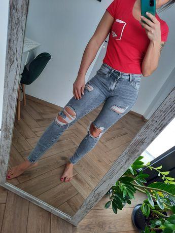 Mega spodnie jeansy rurki dziury xs/s jak nowe