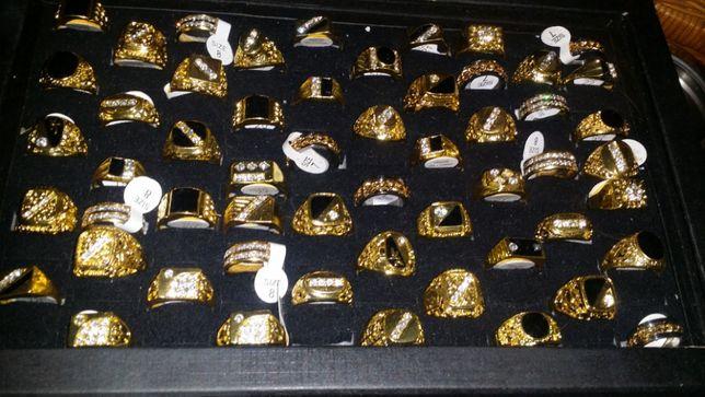 Anéis imitações de aneis em ouro e prata
