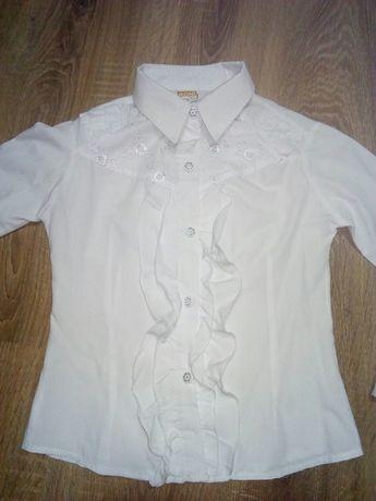 Продам білу блузку.