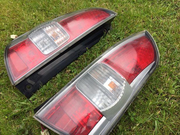 Lampy tył Daihatsu Sirion Subaru Justy