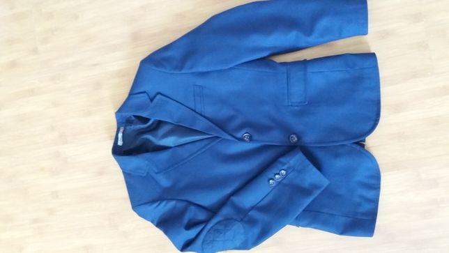Продам пиджак темно-синего цвета,в тонкую еле видную клетку