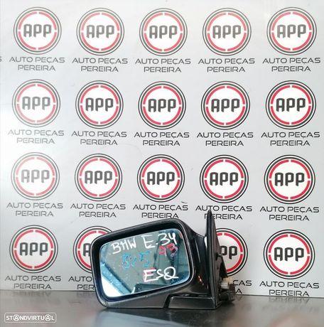Espelho esquerdo BMW E34 eléctrico.