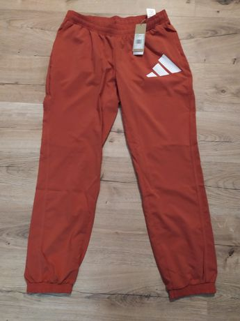 Nowe spodnie damskie Adidas z metką rozmiar L pomarańczowe lekkie