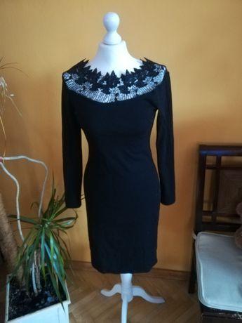 Czarna sukienka l/xl z ozdobnym dekoltem