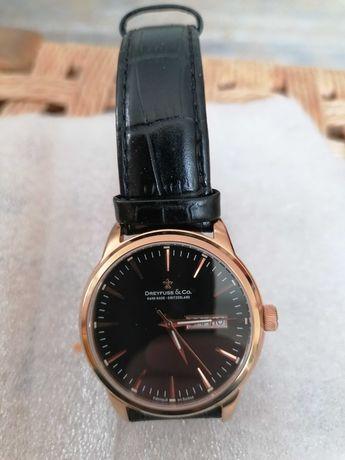 Relógio de homem banhado a ouro, fabricado na Suíça, como novo.